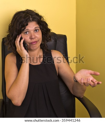 Woman on the mobile phone reacting to call - stock photo