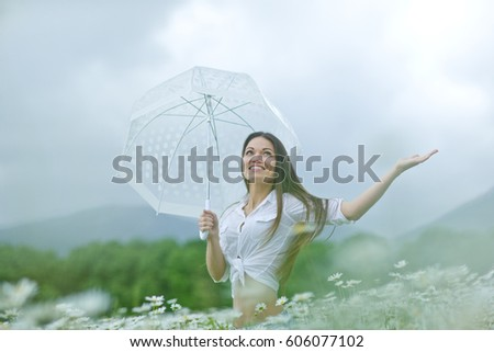 Woman on the nature in the rain