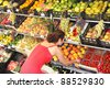 Woman on the roadside fruit stand - stock photo