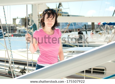 Woman on the yacht in marina in summer - stock photo