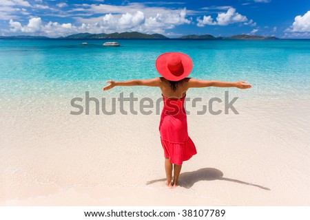 woman on tropical beach in red dress - stock photo