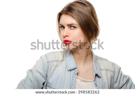 Woman on white background looking suspiciously - stock photo
