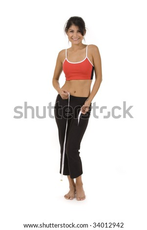 Woman on white background measuring waist with tape measure.