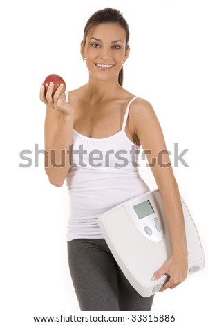 Woman on white holding an apple and scale - stock photo