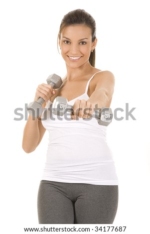 Woman on white holding silver dumbbells to camera. - stock photo