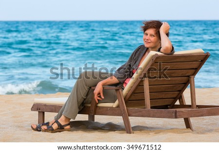 Woman on wooden beach bed. Summer vacation. Bulgaria.