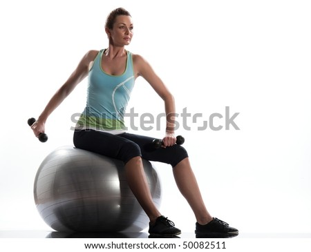 woman on workout posture.  Seated Swiss Ball Unilateral Triceps Extension