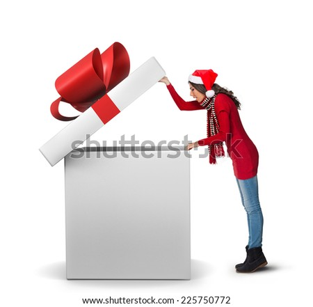Woman opening a large present - stock photo