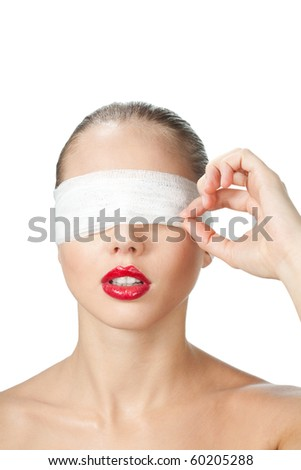 Woman opening bandage after plastic surgery, isolated on white