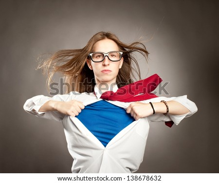 woman opening her shirt like a superhero - stock photo
