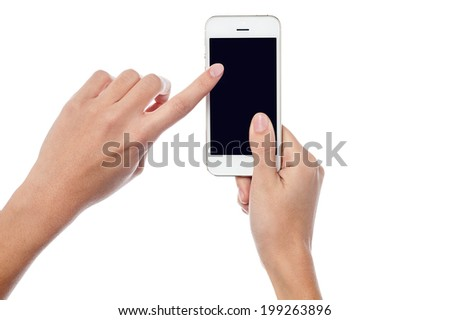 Woman operating touch screen phone - stock photo
