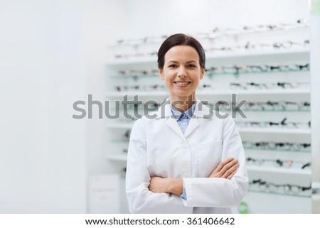 woman optician over glasses at optics store - stock photo