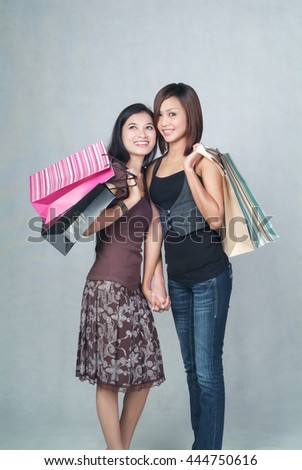 Woman or asian lady holdlding bag on background - stock photo