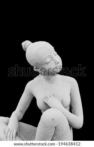 Woman or female statue islated on black background - stock photo