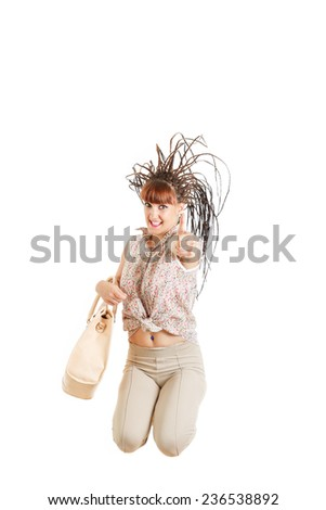 woman or girl jumping with female bag with thumb up of joy excited isolated on white background ,  casual fashion woman. Beautiful Caucasian model smiling. Concept of modern fashion shopping trend - stock photo