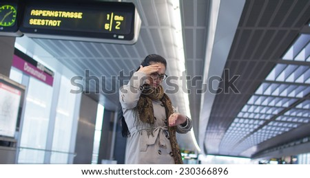 Woman or passenger - traveler was late for a train. Female sowing on her watch - stock photo
