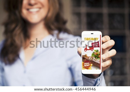 Woman ordering take away food by internet with a mobile phone. - stock photo