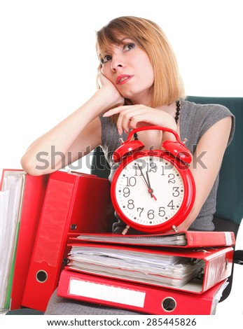 woman overworked businesswoman holding plenty of documents isolated on white red folder and red alarm clock - stock photo