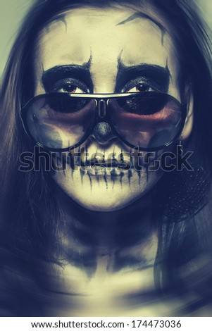 Woman painted as a skeleton with glasses