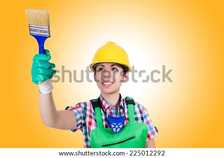 Woman painter with paintbrush on white - stock photo