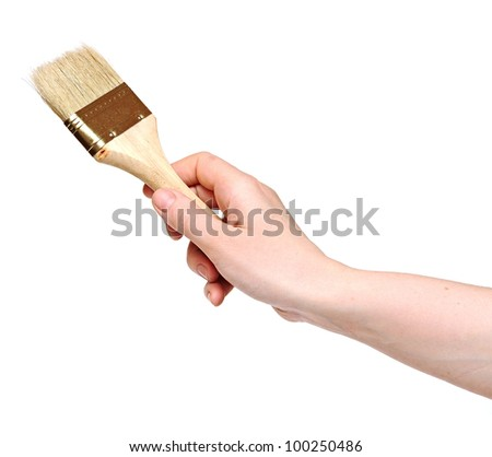 woman painting a wall with a brush - stock photo