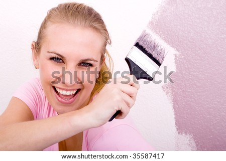 woman painting house - stock photo