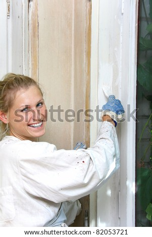 woman painting the window