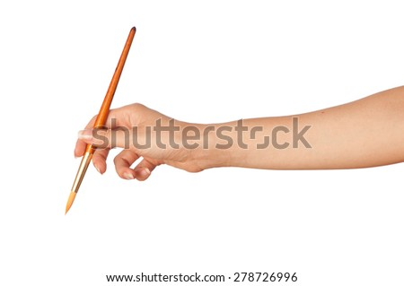 woman paints a picture with a red brush - stock photo