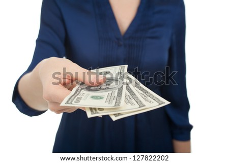 Woman pay with dollar money (three hundreds), white background.