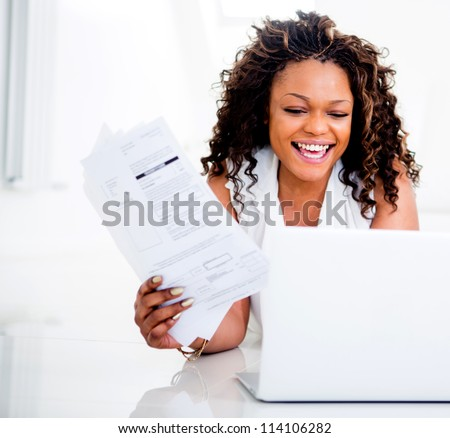 IMPORTANT BIZ Stock-photo-woman-paying-her-bills-at-home-on-her-laptop-114106282