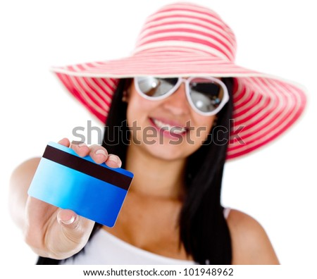 Woman paying her holidays by credit or debit card - isolated over white - stock photo