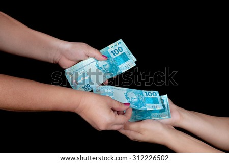 Woman paying with a lot of money - stock photo