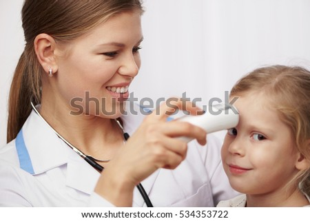 Woman pediatrician measuring temperature of little girl. Concept of medical examination or test.
