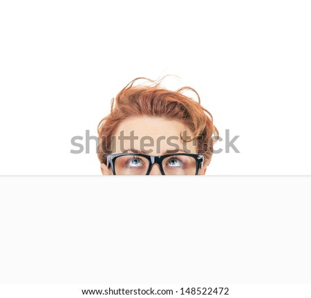 Woman peep out behind blank white board, hide situation - stock photo