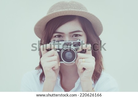 Woman photographer holding film camera on white background, Color effect - stock photo