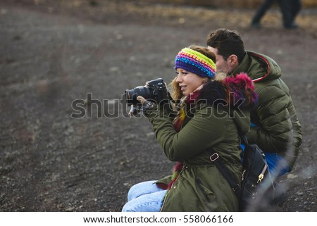 woman photographer with camera making photo