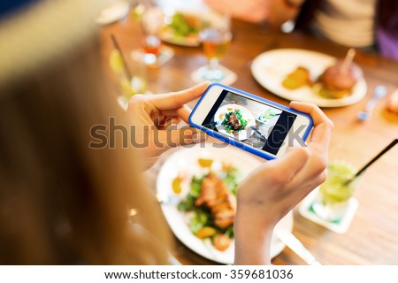 woman photographing food by smartphone  - stock photo
