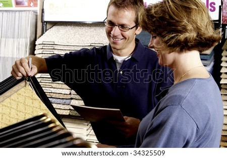woman picking floor sample - stock photo