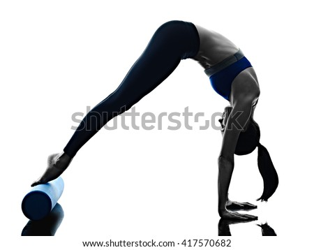 woman pilates roller exercises fitness isolated - stock photo