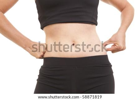 Woman pinching fat on waist - stock photo