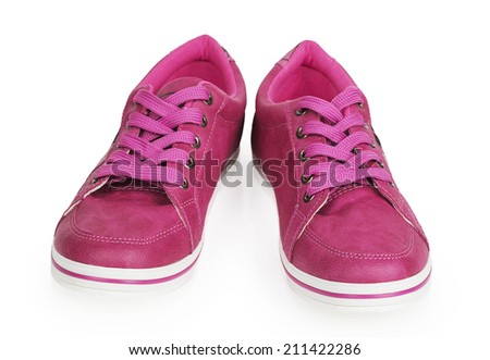 Woman pink sneakers isolated on white background - stock photo
