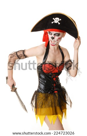 Woman pirate with a sword. Costume for Halloween. Creative make-up - the skull.