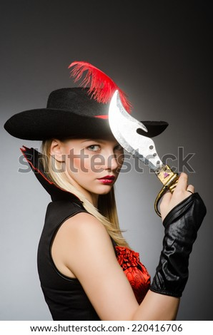 Woman pirate with sharp knife - stock photo