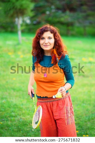 woman playing badminton in the park, sport  - stock photo