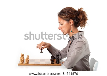 Woman playing chess. White background. - stock photo