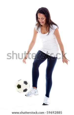 Woman playing football - isolated over a white background - stock photo