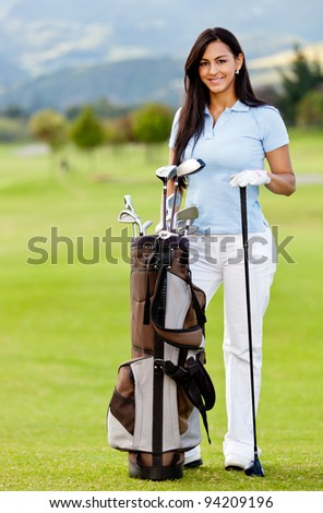 Woman playing golf with a bag at the course