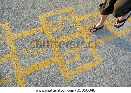 Woman playing hopscotch - stock photo