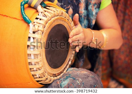 woman playing on traditional Indian tabla drums close up - stock photo
