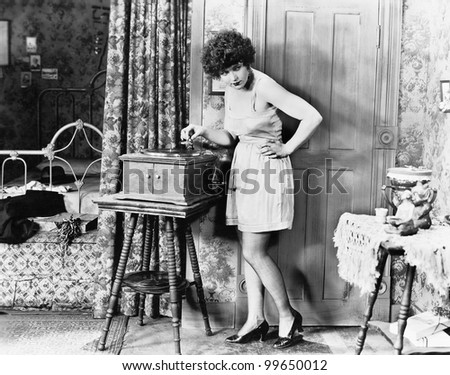 Woman playing record player - stock photo